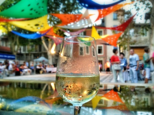 A glass of wine in a Nimes square